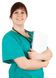 Smiling overweight woman doctor with blank paper Stock Image