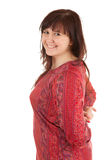 Smiling overweight young woman in red dress Stock Photos