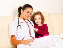 Smiling padiatrician with a little girl Stock Image