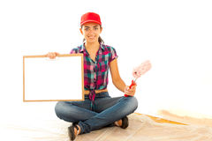 Smiling painter girl with clipboard Royalty Free Stock Image