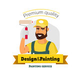 Smiling painter is holding brush Stock Photo