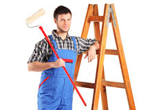Smiling painter with a paint roller posing Royalty Free Stock Photos