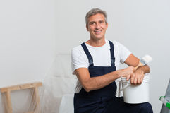 Smiling Painter. Portrait Of Happy Mature Painter With Stepladder And Paint Bucket Stock Photo