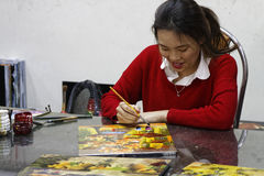 Smiling painter in the workshop Stock Images