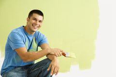 Smiling painting man. royalty free stock photography