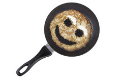 Smiling pancake on a griddle Stock Image