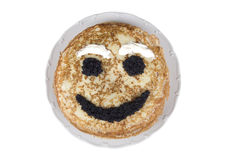Smiling pancake on a plate Royalty Free Stock Image
