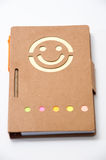 Smiling paper notebook on the white background Royalty Free Stock Photo