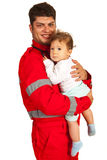 Smiling paramedic man holding baby Royalty Free Stock Photography