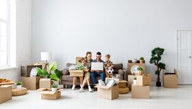 Free Smiling Parents And Children Browsing Laptop In New Apartment Stock Image - 210072771