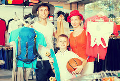 Smiling parents with boy shopping hiking goods Royalty Free Stock Photos