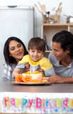 Smiling parents celebrating their son's birthday Royalty Free Stock Image