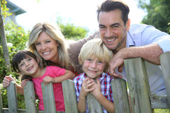 Smiling parents with children outdoors Stock Photo