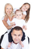 Smiling parents with children on white background Royalty Free Stock Photo