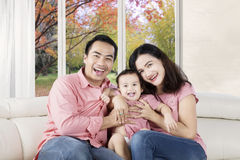 Smiling parents embracing daughter Royalty Free Stock Photo