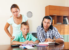 Smiling parents helping with homework Royalty Free Stock Images
