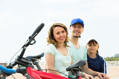 Smiling parents with kid having rest Royalty Free Stock Photos