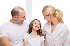 Smiling parents and little girl at home Royalty Free Stock Photo