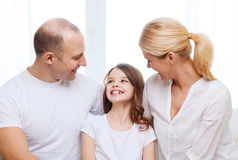 Smiling parents and little girl at home Royalty Free Stock Image