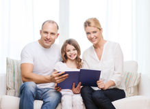 Smiling parents and little girl with at home Royalty Free Stock Photos