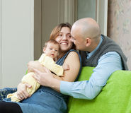 Smiling parents with newborn in home Stock Photography