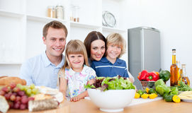 Smiling parents and their children at home Royalty Free Stock Photos