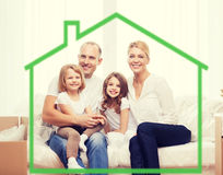Smiling parents and two little girls at new home Stock Photo