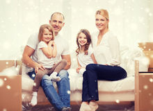 Smiling parents and two little girls at new home Royalty Free Stock Photography