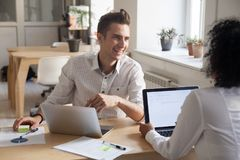 Smiling partners talking brainstorming during office meeting Royalty Free Stock Image