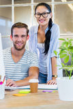 Smiling partners working together on computer Royalty Free Stock Images