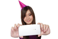 Smiling party girl taking selfie, on white Royalty Free Stock Image