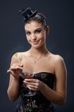 Smiling party woman with cocktail Royalty Free Stock Photo