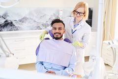 Smiling Patient at Dental Room stock images
