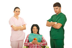 Smiling patient with dentist team Stock Image