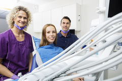 Smiling Patient With Dentists In Clinic Royalty Free Stock Photos