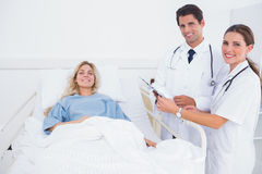 Smiling patient and doctors Stock Images