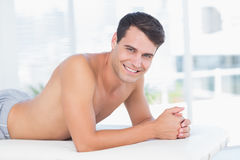 Smiling patient lying on massage table and looking at camera Royalty Free Stock Photo