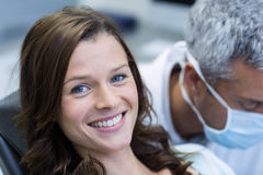 Smiling patient sitting on dentist chair Stock Image