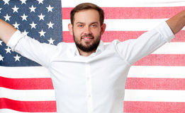 Smiling patriotic man holding United States flag. USA celebrate 4th July. American flag. Smiling patriotic man holding United States flag. USA celebrate 4th Royalty Free Stock Photo