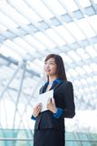 Smiling pensive business woman Stock Photo