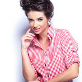 Smiling pensive casual woman Royalty Free Stock Image