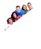 Smiling people with broadsheet. Smiling people group with big poster over white background Stock Photos