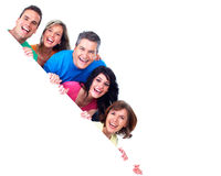 Smiling people with broadsheet. Smiling people group with big poster over white background Stock Image