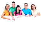Smiling people with broadsheet. Smiling people group with big poster over white background Royalty Free Stock Photos