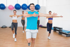 Smiling people doing power fitness exercise in fitness studio Royalty Free Stock Image
