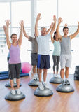 Smiling people doing power fitness exercise Stock Images