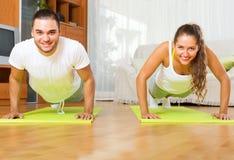 Smiling people doing yoga indoor Stock Image