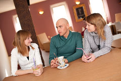 Smiling people drinking coffee and having fun Royalty Free Stock Photos