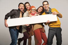 Smiling people with empty board Stock Image