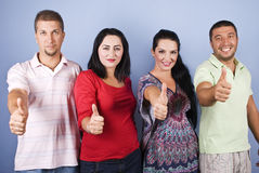 Smiling people giving thumbs up Stock Images